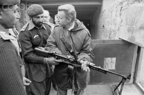 "US FOREIGN POLICY ADVICE IN THE KYBER PASS: Brzezinski manhandles a machine gun at a Pakistan Army outpost after having armed the ""stirred-up Moslems"" who comprised the Mujahideen (February 3, 1980)."