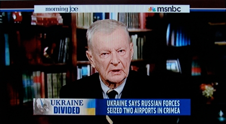 ORWELLIAN DOUBLETHINK: In his paternal 'nation as person' role, Zbigniew Brzezinski deploys his expert brain powers for a 'noble cause', while also slyly endorsing the permanent war economy.