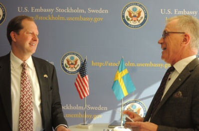STOCKHOLM SYNDROME REVISITED: Mika's brother Mark Brzezinski at his new job in Sweden. Those with power act most obediently to the logic of its organizing system, even in the presence of toy flags.
