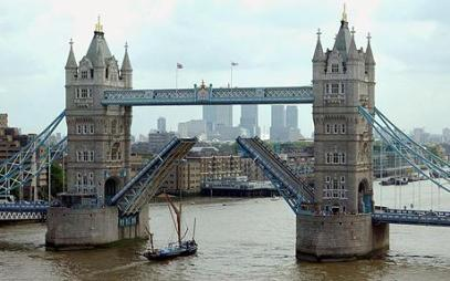 Broom Chase: Rik Mayall pursued John Key as they rode magic brooms at high speed under Tower Bridge, London, while arguing about financial wizardry.