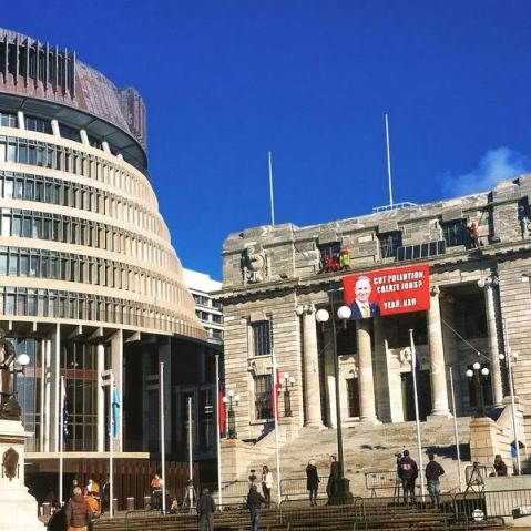 Framing Irony: Greenpeace abseilers say they will forgo diversion from prison, while the news media construct a diversionary argument with a trivial objection about the breach of security at the New Zealand economy's parliament.